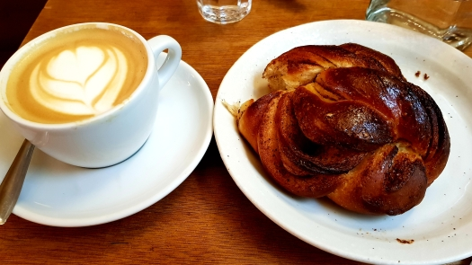 Cappuccino and Cinnamon Roll Fragments Coffee Paris France